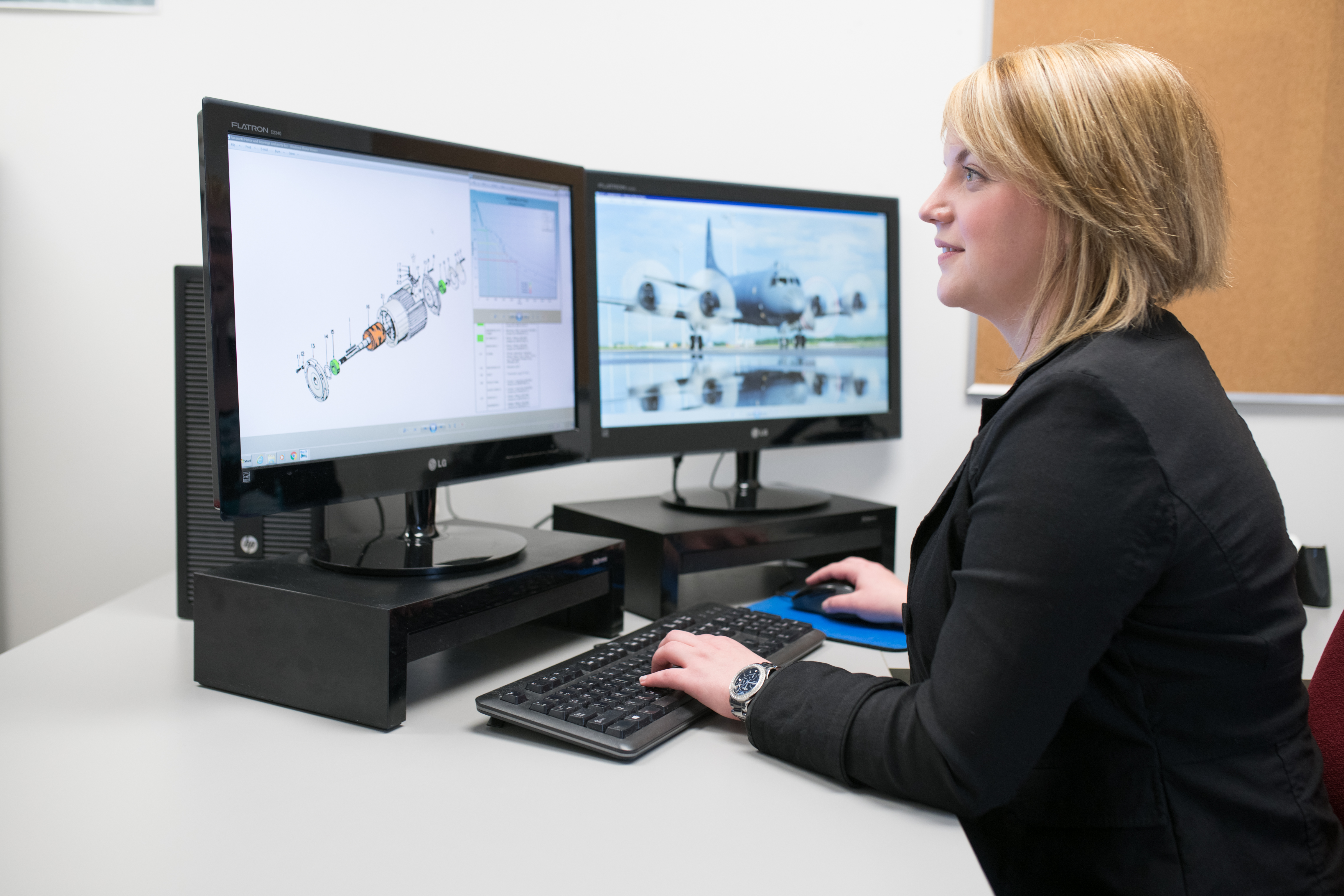 Engineer working on renderings of an aircraft component