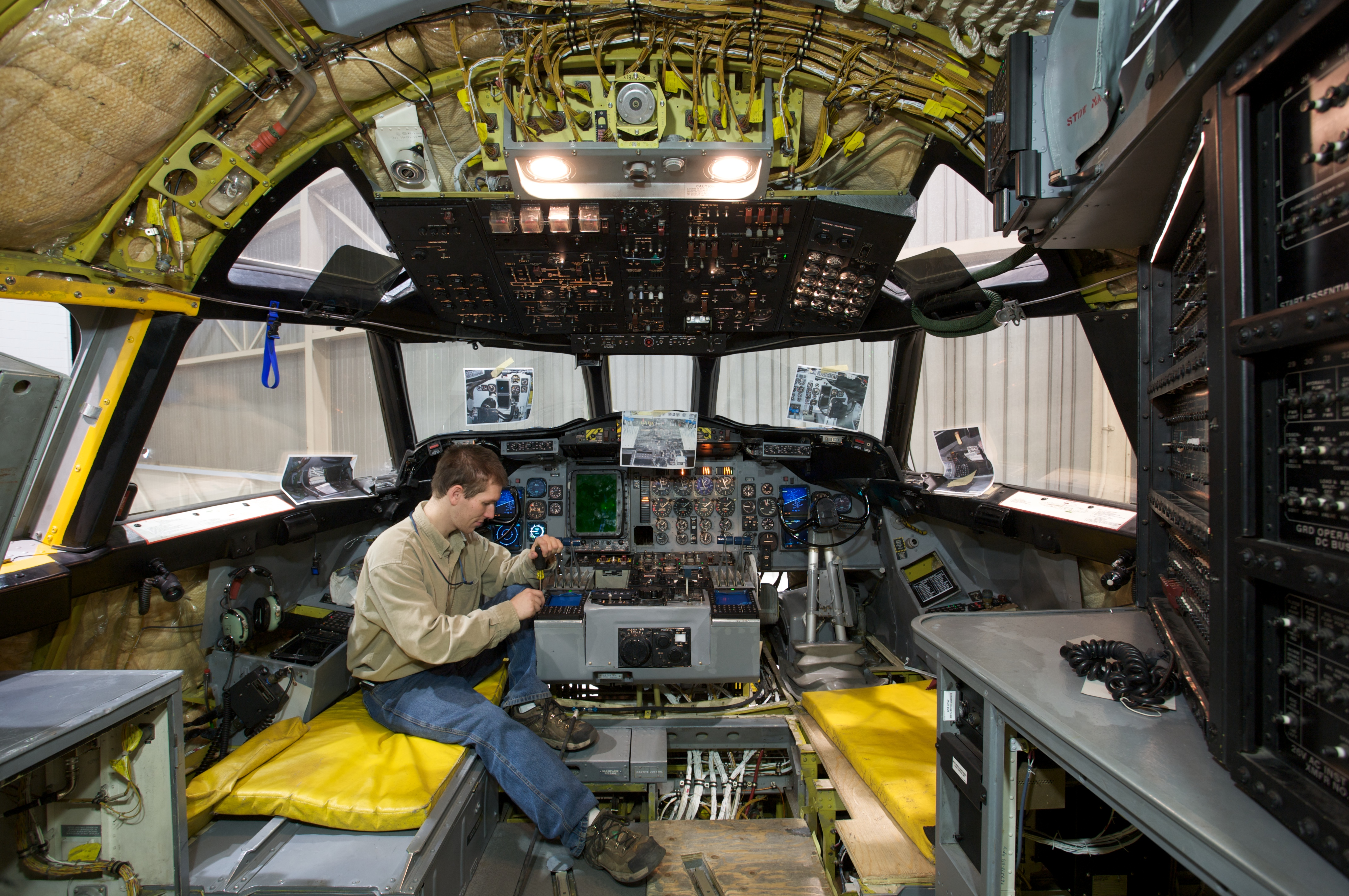 Aerospace Engineer working on the inside of an aircraft
